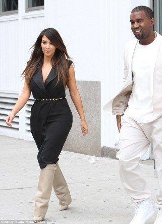 Trying to keep them under-Kover! Kim Kardashian grapples with her cleavage-baring dress as she shops with Kanye   5